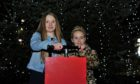 Mya Leone and Alicia Troup switched on the Ellon Christmas tree lights