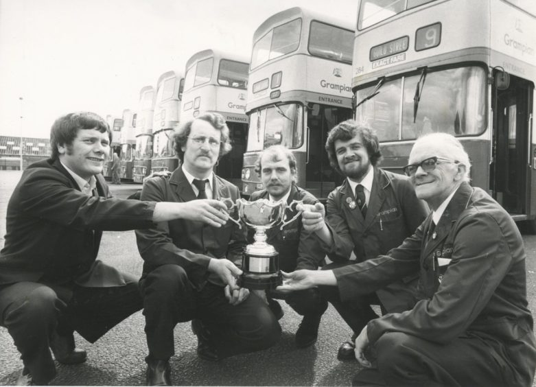 1982: Grampian Regional Transport First Aid team proudly show off the Braithwaite Trophy they drove off with for gaining the highest individual marks in the National Road Passenger Transport Association (Northern Area) competition which was held at Lothian Region Transport's central garage in Edinburgh. The team who were placed third overall are (left to right) Mr Fred Thouless, Mr Sandy Fleming, Mr David Goymer, Mr John Thomson and Mr Jack Thomson, all Aberdeen.