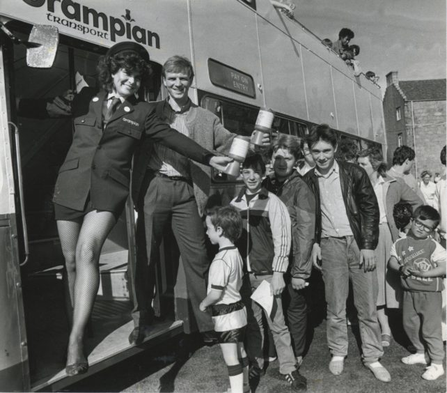 1986: Dons star Alex McLeish and Terry Glossotis welcome passengers for a free trip round town at yesterday's Grampian Transport open day. They also collected donations for the Linn Moor appeal.