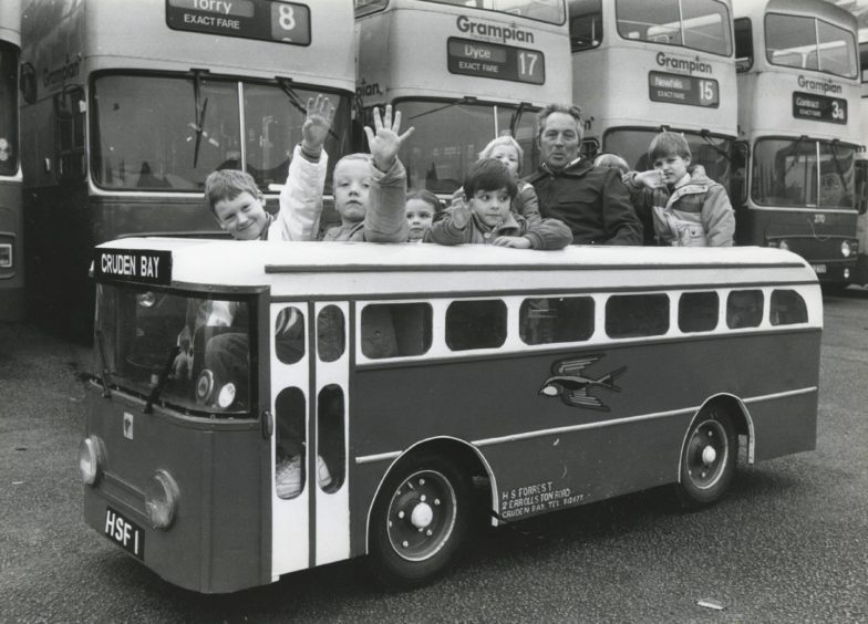 1987: At the wheel of the children's fun bus was Harry Forrest, Cruden Bay.