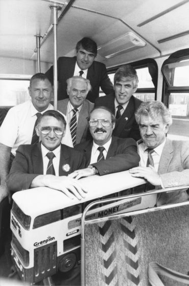 1991: Still on the buses after many years work are six Grampian Regional Transport employees, who received long service awards from the company. In the front row are (from left) Alex Wilson (bus driver for 35 years), Alex Sutherland (bus driver for 40 years) and Lenny McDonald (electrical engineering supervisor for 40 years). Getting awards for 25 years service are (back row, from left), Kenny Esson (bus driver) Stanley England (bus cleaner), managing director and chairman of the company Moir Lockhead and Gordon Craig (bus driver).