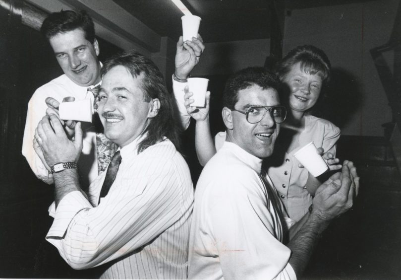 1991: Ready for a drink are Grampian Transport drivers Alan Killin (left) and Neil Warden, after raising £260 in the Evening Express Half Marathon for cerebal palsy sufferer, Scott Cameron (5), Marchburn Court, Northfield, Aberdeen. Scott's parents Brian and Denise, were at a charity night raised £1,145.99. The cash will buy a walking frame for Scott.