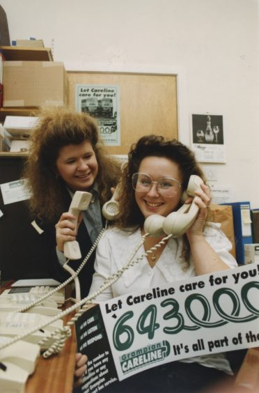 1991: Grampian Transport careline officer Lynn Anderson (right) mans the new phoneline, watched by marketing officer Shona Byrne.