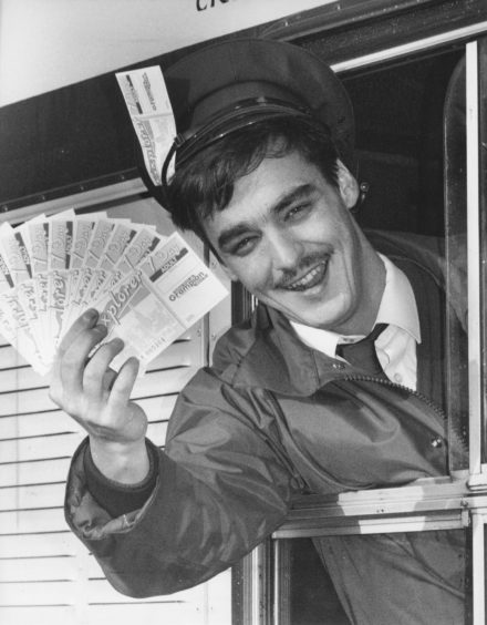 1992: Grampian Transport bus driver Shaun Gray, Bridge of Don, shows off the lucky bus pass tickets you could win if you help Cut The Rush.