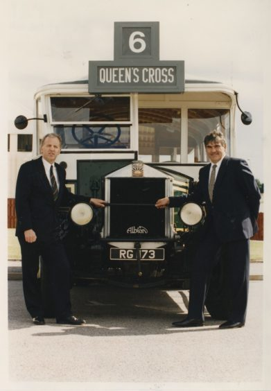 1994 Managing director Robbie Duncan (left) and chairman Moir Lockhead, seen beside an old Aberdeen bus at yesterday's AGM held in the Aberdeen Exhibition and Conference Centre.