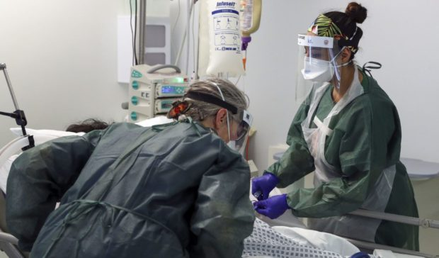 Hospital staff treating a patient with Covid-19