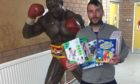Lee with donations for the Christmas present appeal