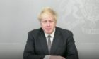 Prime Minister Boris Johnson, who is absolutely not in a cupboard.