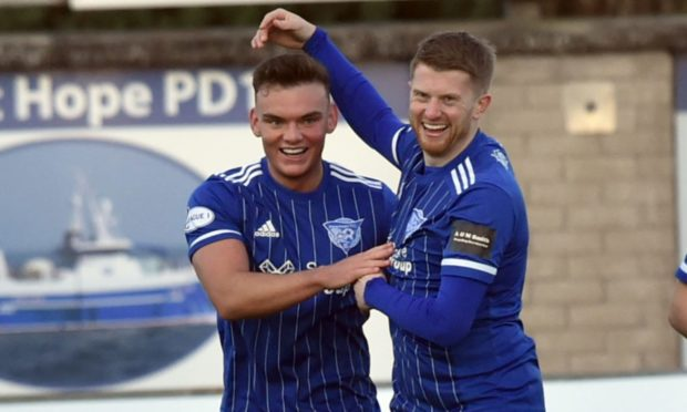 Ben Armour, left, celebrates his winning goal against Dumbarton with Alan Cook, right.