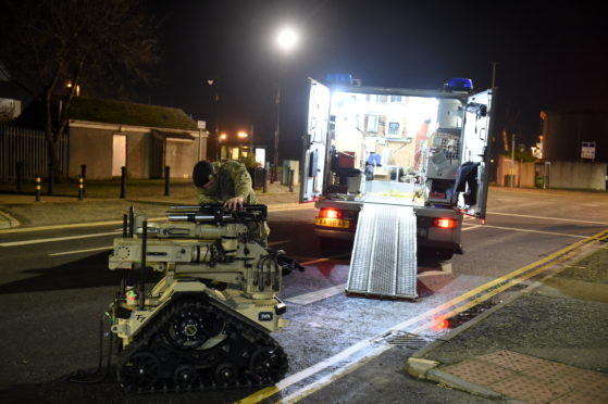 Bomb disposal experts leaving the scene in Torry tonight. Picture by Paul Glendell