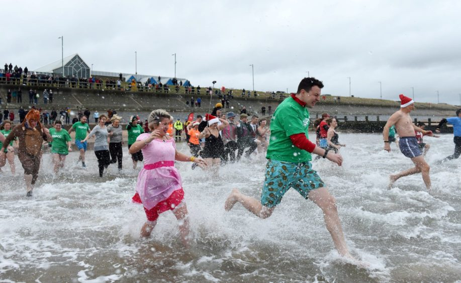 Last year's Boxing Day Nippy Dipper plunge in Aberdeen.