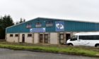 A small number of Covid-19 cases have been linked to Seafood Ecosse in Peterhead.