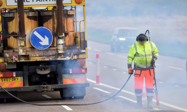 Aberdeen City Council workers begin the process of removing the cycle lane from Aberdeen beach.