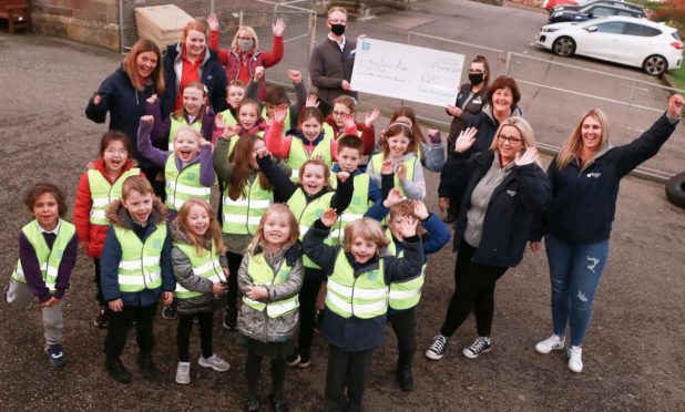 Stonehaven After School Club donning their new vests.