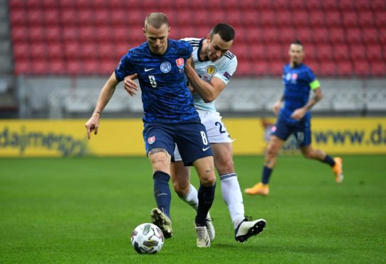 Slovakia's Ondrej Duda (left) and Scotland's Andy Considine battle for the ball.