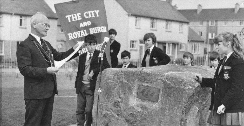 1969: Lord Provost Lennox reads the words on the plaque after unveiling the flag over the boulder.