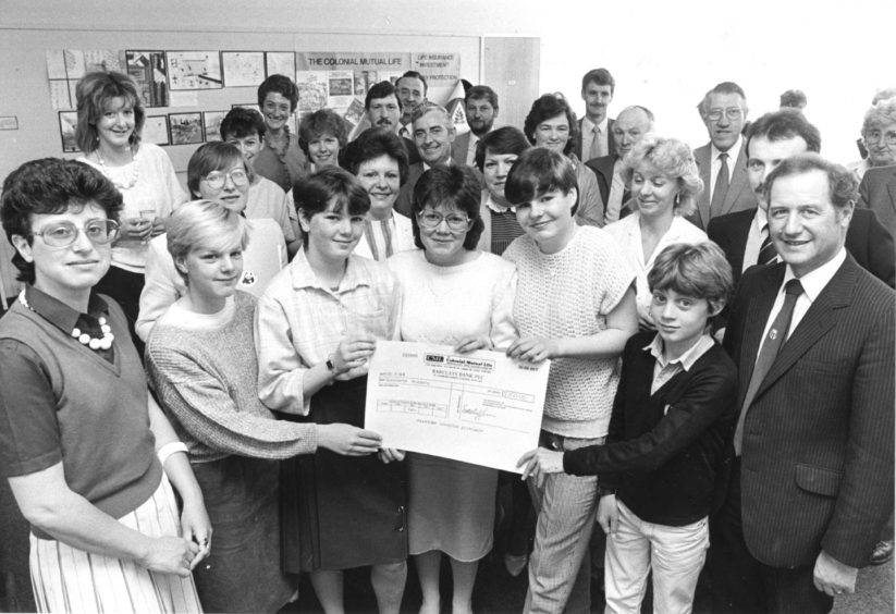 1984: Receiving the £200 cheque from regional sales manager Hugh Watson (right) are from left art teacher Tina Stockman and pupils Sharon Anderson, Carole Shaw, Karen McWilliam, Alison Scott, and Bruce Sangster.
