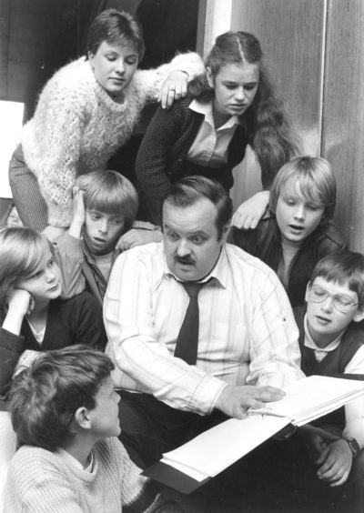 """1984: Some of the Summerhill Academy """"orphans"""" pictured with guidance teacher Mr Kieran Walsh who plays Dr Barnardo in their forthcoming show Carrots. The """"orphans"""" in the picture are John Robertson, Stephen Smith, Margaret Croll, Julie Garden, Colin Findlater, Tracey Breen and Graeme Massie."""