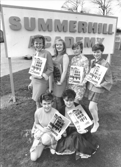 1987: Sixties girls with the silver jubilee magazine. Back (left to right) Sharon McGregor, Vanessa Vass, Tracy Farquhar and Karen McHattie. In front  - Paula Connelly (left) and Lorraine Felbar
