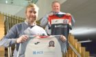 ACE Winches CEO George Fisher, right, with Turriff United manager Kris Hunter.