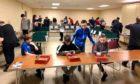 Members of the 1st Ellon Boys' Brigade sorting cards last year.
