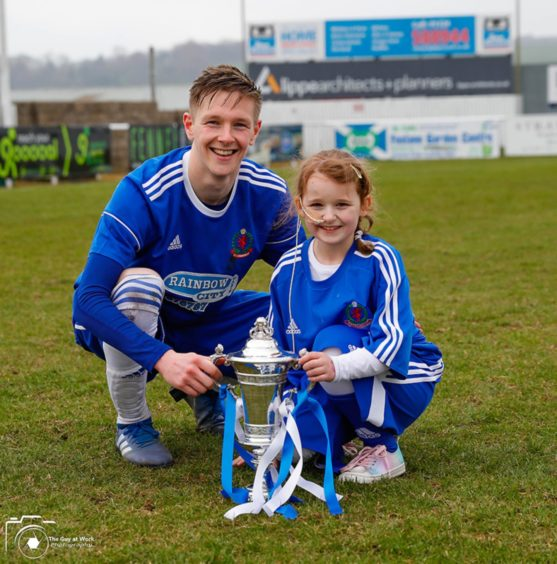 Megan with Cove Rangers midfielder Blair Yule after she served as the team's mascot.