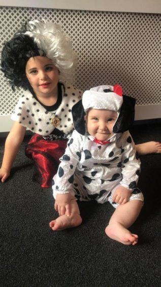 Bleu, 4, and Billie, 7 months dressed up as Cruella De Ville and a dalmatian. Keith. Supplied by Amy Mo Glover