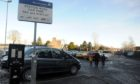 Income is expected to be down when car parking charges resume in January.