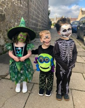 Harry (4) Jack (3) and Maisie (3) Ferguson on their way to nursery, Aberdeen. Supplied by Claire Hopley