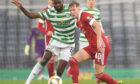 Ross McCrorie, right, battles for possession with Odsonne Edouard of Celtic.