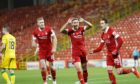 Scott Wright celebrates netting against Hibs on his last Aberdeen outing.