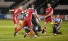 Curtis Main has an effort on goal for Aberdeen against St Mirren.