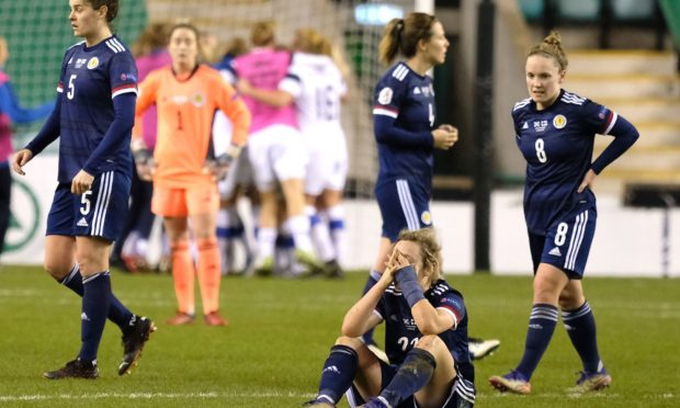 Erin Cuthbert of Scotland is inconsolable after Amanda Rantanen of Finland scores when the ball rebounded off her face to make it 0-1 in the last minute.