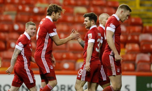 Aberdeen defender Ash Taylor celebrates his goal to make it 2-1 against St Johnstone with Matty Kennedy.