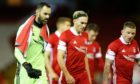 Aberdeen goalkeeper and captain Joe Lewis, left, walks off after the win against St Johnstone with Ryan Hedges and Jonny Hayes.