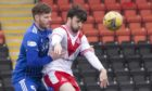 Gary MacKenzie, left, in action for Peterhead.