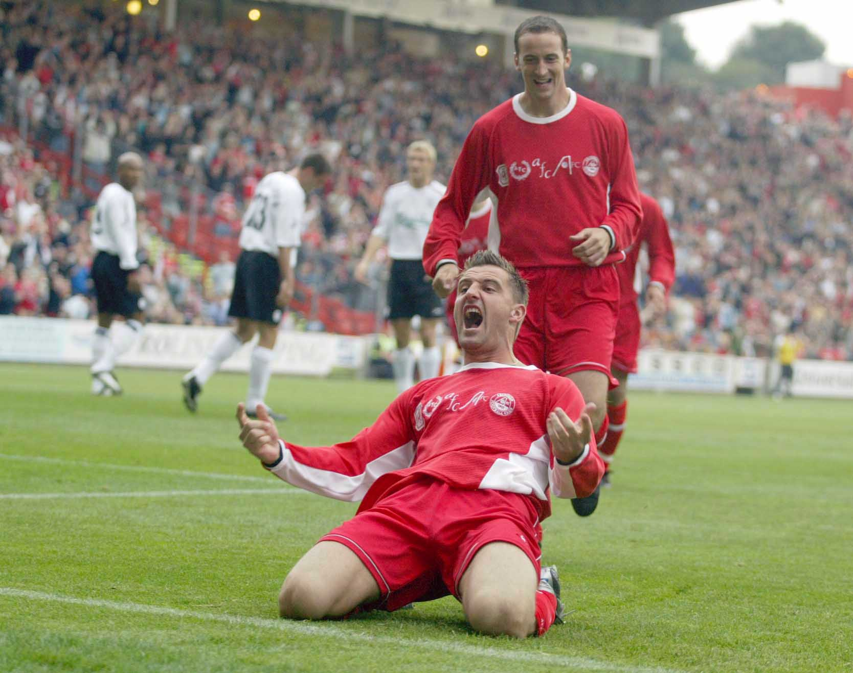 David Zdrillic celebrates his goal for Aberdeen against Liverpool at Pittodrie in 2003.