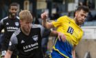 Peterhead's Kieran Freeman and Guy Elhamed during a Betfred Cup match between Peterhead and St Johnstone.