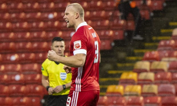 Curtis Main celebrates scoring the opener against Ross County.