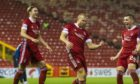 Curtis Main, centre, celebrates his second goal against Ross County