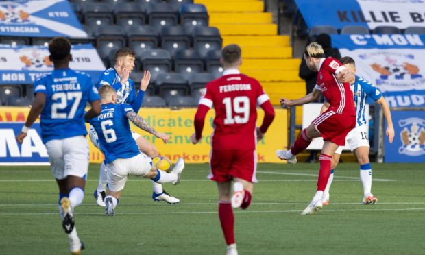 Aberdeen's Ryan Hedges (R) makes it 1-0 with a strike that deflects off Kilmarnock's Stuart Findlay