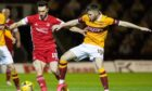 Aberdeen's Connor McLennan (L) is challenged by Liam Polworth of Motherwell.