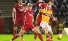 Ross McCrorie, left, battles for possession with Allan Campbell
