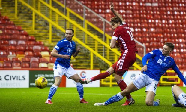 Aberdeen's Ash Taylor (centre) makes it 2-1 against St Johnstone.