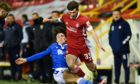 Aberdeen's Matty Kennedy (R) is tackled by St Johnstone's Danny McNamara on Boxing Day.