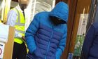 Callum Findlay hid his face as he left the court.