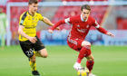 Aberdeen's Scott Wright (right) and NSI Runavik's Morits Heini Mortensen battle for the ball during a UEFA Europa League qualifying first round match at Pittodrie Stadium, Aberdeen.