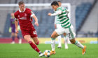 Celtic's Mohamed Elyounoussi (right) and Aberdeen's Ross McCrorie battle for the ball during the William Hill Scottish Cup semi-final match at Hampden Park on November 1.