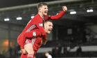 Matty Kennedy and Mikey Devlin (right) celebrate at full time during the Scottish Cup Quarter Final match between St. Mirren in February.