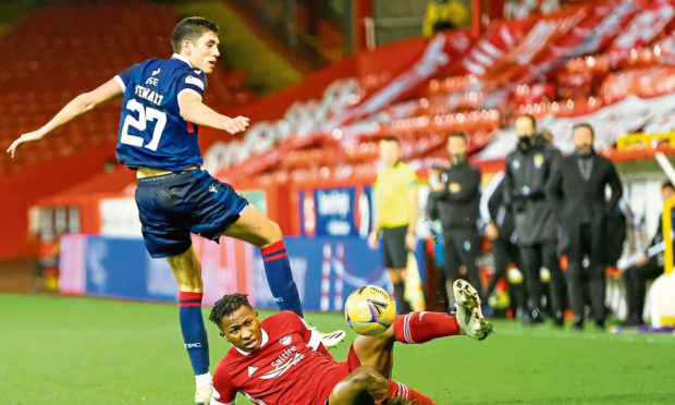 Aberdeen's Kieran Ngwenya and Ross County's Ross Stewart (27) battle for the ball on Saturday. Could Stewart soon be a Don?